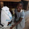 Clinton Brings 'Buckets to Backpacks' Program to Rwanda