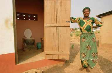 Rakiya Abdullah next to her latrine, Sagnarigu, Tamale, Northern Region, Ghana. WaterAid