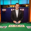 Host Bill Rancic gets ready to deal the cards in Food Network's Kitchen Casino