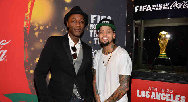 Aloe Blacc and David Correy at the FIFA World Cup Trophy Tour by Coca-Cola experience in Los Angeles before performing 'The World is Ours' by Aloe Blacc x David Correy.