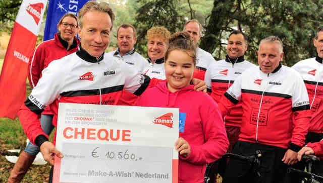 Axalta's Tonio Amaddeo presents check to ambassador for Make-A-Wish, Juliette.