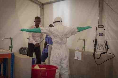 Prospective health-care workers in the Kerry Town Ebola Treatment Center test decontamination procedures in Sierra Leone. Photo by Louis Leeson / Save the Children.