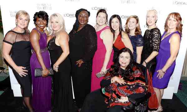 (L-R) 2014 L'Oreal Paris Women of Worth Honorees Jenny Williamson, Rachel R. Jackson-Bramwell, Stephanie Decker, Shaaron Funderburk, Corinne Cannon, Phyllis Sudman, Brittany Wenger, Audra Dipadova Wilford, Deborah Snyder (Front) Mary K. Hoodhood at Women of Worth celebration at The Pierre on December 2, 2014 in New York City.