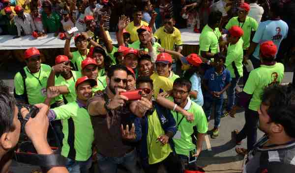 Actor Salil Acharya taking a selfie with kids at the Don Bosco Mela sponsored by WWE