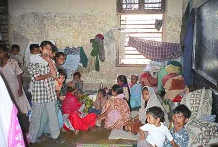 A room in the Dariyakhan Ghummat relief camp in Ahmedabad housing over 50 women and children in 2002. The camp held 5,100 people and is one of approximately one hundred relief camps in Gujarat, where 98,000 people, a great majority of them Muslim, have been displaced by the violence. Photo courtesy: Smita Narula / Human Rights Watch