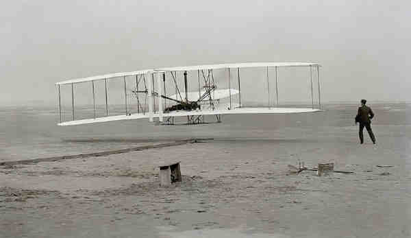 The Wright Flyer: the first sustained flight with a powered, controlled aircraft.