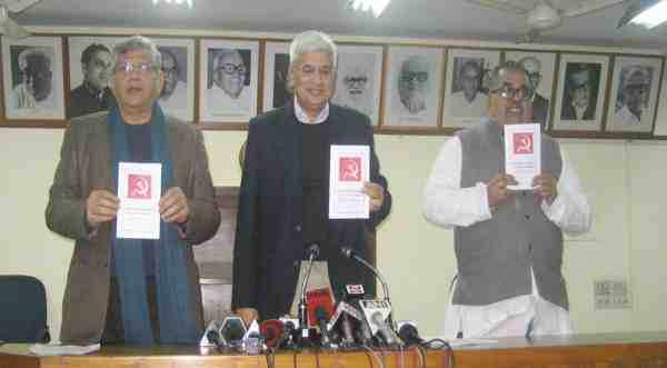 CPI-M leaders Sitaram Yechury, Prakash Karat, and K.Varadharajan releasing the draft political resolution for the 21st Congress.
