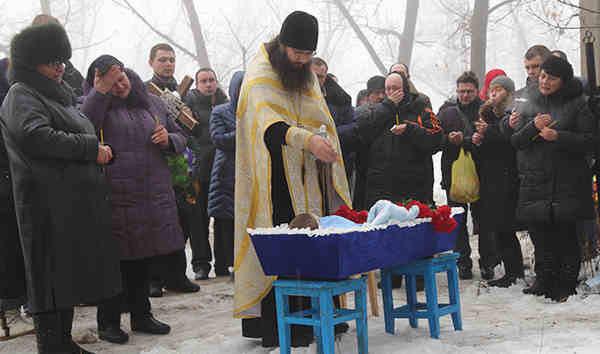 Funeral for a four-year-old boy who was killed when a shell struck his family's house in Donetsk on January 18, 2015.