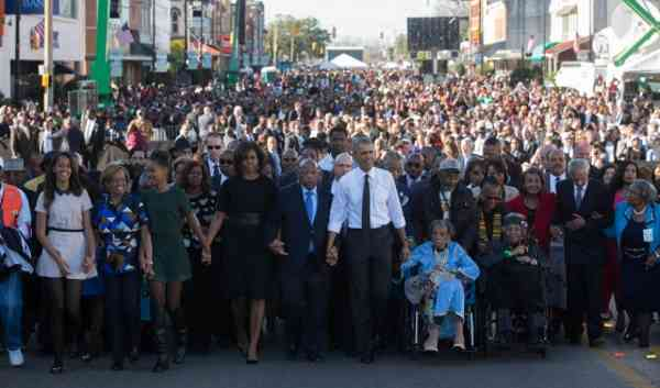 President Barack Obama, First Lady Michelle Obama and daughters Sasha and Malia wait with former President George W. Bush, former First Lady Laura Bush prior to the walking across the Edmund Pettus Bridge to commemorate the 50th Anniversary of the Selma to Montgomery civil rights marches, in Selma, Alabama, March 7, 2015. (Official White House Photo by Lawrence Jackson)