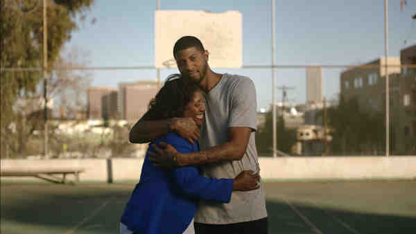 NBA All-Star Paul George with his mom, Paulette
