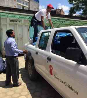 Save the Children staff unload emergency supplies for children and families left homeless by the earthquake in Nepal.