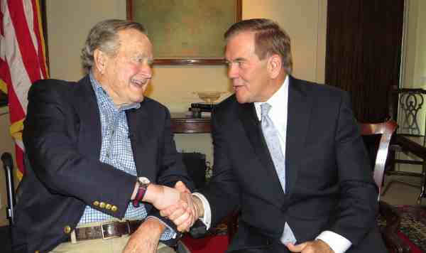 President George H.W. Bush, Honorary Chairman of the National Organization on Disability, shaking hands with Tom Ridge, Chairman of the National Organization on Disability