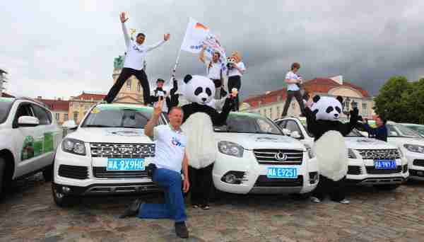 "The European fans of giant panda and the SUVs ""made in Chengdu"" made their stage poses in Charlottenburg Palace in Berlin, Germany"