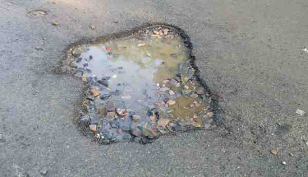 The condition of roads in Delhi shows that India is still an underdeveloped country.