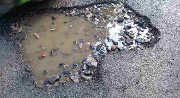 Political and bureaucratic corruption is the main cause of broken roads in Delhi. Photo: Rakesh Raman