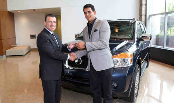 Tennessee Titans QB Marcus Mariota is presented the keys to a 2015 Nissan Armada by Fred Diaz, SVP, Nissan Sales and Marketing and Operations, USA, Tuesday, July 28, 2015, in Nashville, Tennessee, at Nissan North America headquarters.
