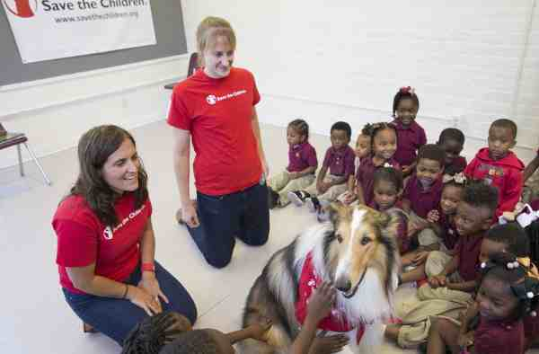 "Save the Children Animal Ambassador Lassie delights children at a Save the Children ""Prep Rally"" at the Kingsley House Head Start Program in New Orleans. Photo by Lee Celano/Getty."