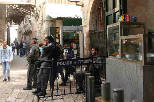 Israeli forces and a newly installed metal detector on the corner of Al Wad Street, in Jerusalem's Old City. Photo: Mya Guarnieri/IRIN