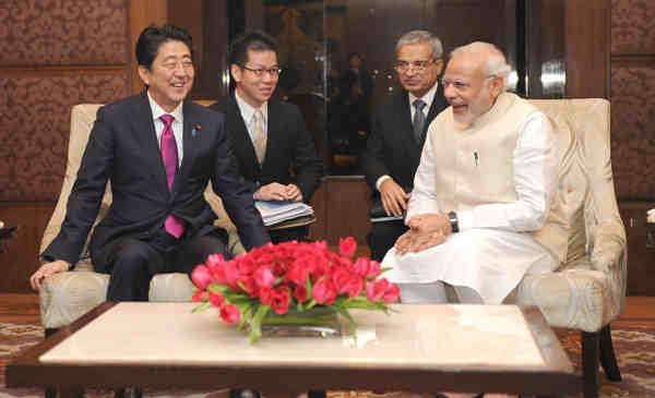 Shinzo Abe and Narendra Modi before the start of India-Japan Business Leaders Forum, in New Delhi on December 12, 2015