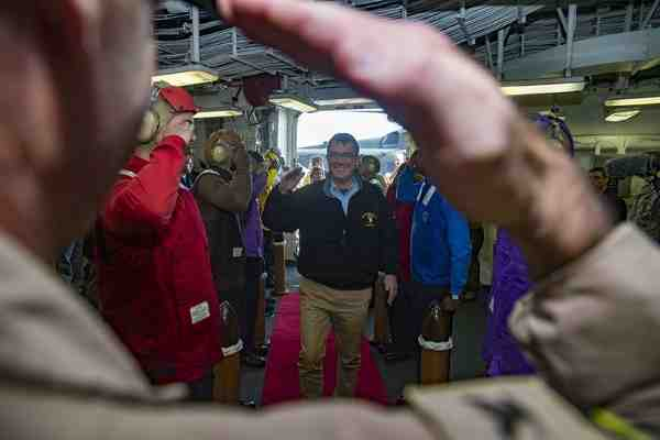 U.S. Defense Secretary Ash Carter arrives aboard the amphibious assault ship USS Kearsarge in the Arabian Gulf, Dec. 19, 2015.