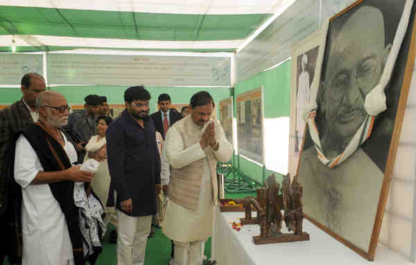 Dr. Mahesh Sharma paying homage at the portrait of Mahatma Gandhi, during the inauguration of the exhibition 'Mohan Se Mahatma Tak' at Rajghat Samadhi Samiti, in Delhi on January 30, 2016