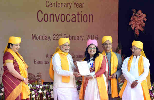 Narendra Modi felicitating the awardees at the Centenary Year Convocation of the Banaras Hindu University (BHU), in Varanasi on February 22, 2016. The Union Minister for Human Resource Development, Smriti Irani, is also seen.