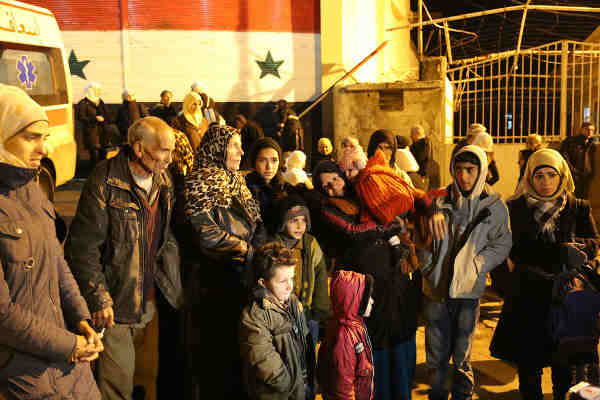 In the besieged Syrian town of Madaya, people are waiting desperately to be allowed out because of lack of food and skyrocketing food prices. Photo: WFP / Hussam Al Saleh