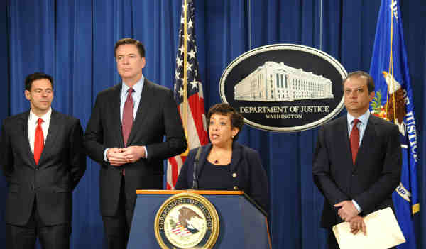 Attorney General Loretta Lynch—joined by (from left) Assistant Attorney General for National Security John Carlin, FBI Director James Comey, and U.S. Attorney Preet Bharara of the Southern District of New York—announces indictments against seven Iranian hackers for cyber crimes against the U.S. financial sector at a press conference on March 24, 2016 at the Department of Justice in Washington, D.C.