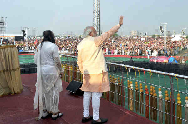 "Narendra Modi at the inaugural ceremony of the World Culture Festival, in New Delhi on March 11, 2016. Founder of the ""Art of Living Foundation"", Sri Sri Ravi Shankar is also seen."