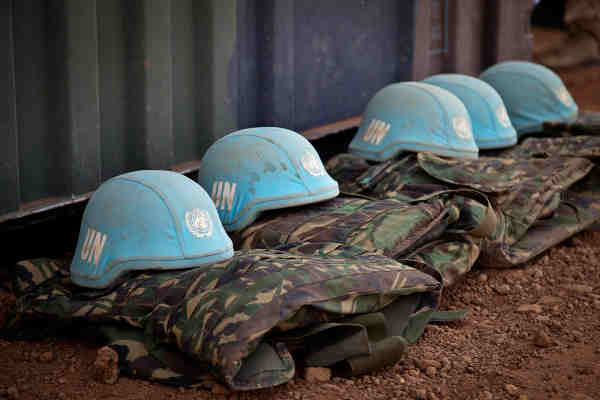 Blue helmets and uniforms of UN Peacekeepers. UN Photo / Marco Dormino