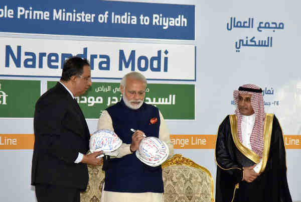 Narendra Modi signing the helmet, during his visit to the L&T residential complex, in Riyadh, Saudi Arabia on April 02, 2016