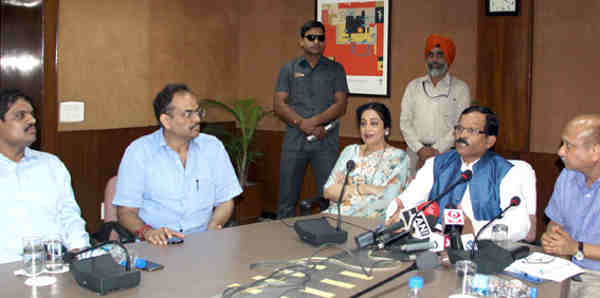 "Minister of State for AYUSH and Health & Family Welfare, Shripad Yesso Naik, the Member of Parliament, Chandigarh, Kirron Kher and the Secretary, AYUSH, Ajit M. Sharan talking about the arrangements for the ""International Day of Yoga-2016"", in Chandigarh on June 10, 2016."