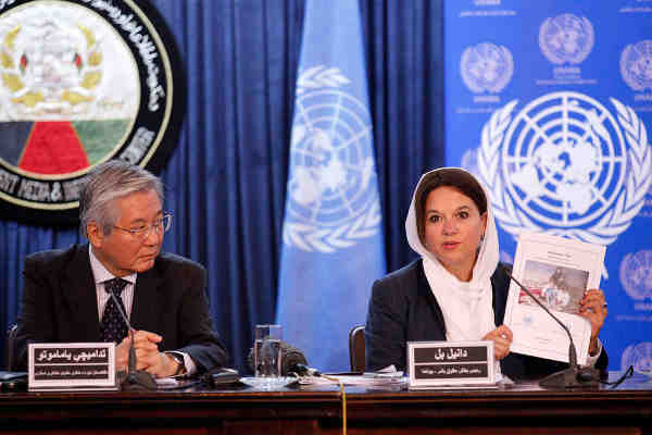 At a press conference in Kabul, (left) Tadamichi Yamamoto, the Secretary-General's Special Representative for Afghanistan and head of UNAMA, and (right) Danielle Bell, Director, Human Rights Unit, UNAMA, present latest report on civilian casualties. Photo: UNAMA / Fardin Waezi.