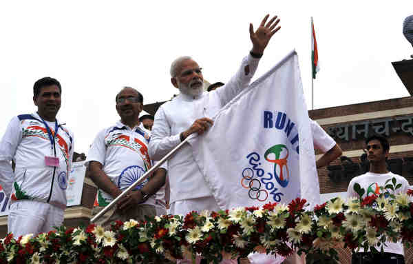 "Narendra Modi flagging off the ""Run For Rio"", at Major Dhyan Chand National Stadium, in New Delhi on July 31, 2016"