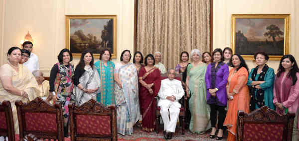 "Pranab Mukherjee in a group photograph, during receiving the Coffee Table Book ""India's Most Powerful Women"" from Ms. Prem Ahluwalia, Associate Editor, Young India, at Rashtrapati Bhavan, in New Delhi on July 28, 2016"