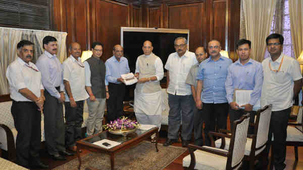 Madhukar Gupta presents report to the Union Home Minister, Rajnath Singh, in New Delhi on August 29, 2016