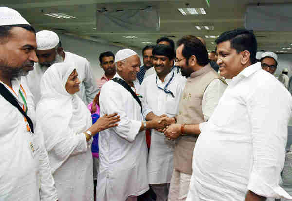 Mukhtar Abbas Naqvi greeting the Haj Pilgrims, during the first flight flag-off ceremony, in New Delhi on August 03, 2016
