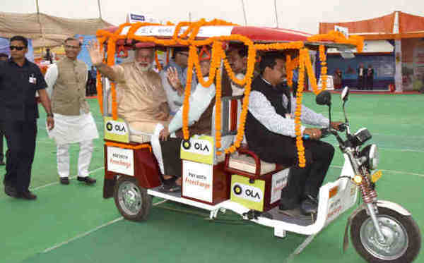 PM Narendra Modi taking a ride on e-Rickshaw, on the launch of 'Stand up India' programme, in Noida, Uttar Pradesh on April 05, 2016
