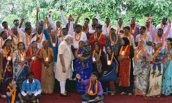 Narendra Modi interacting with the Village Pradhans from Varanasi Parliamentary Constituency, in New Delhi on August 08, 2016