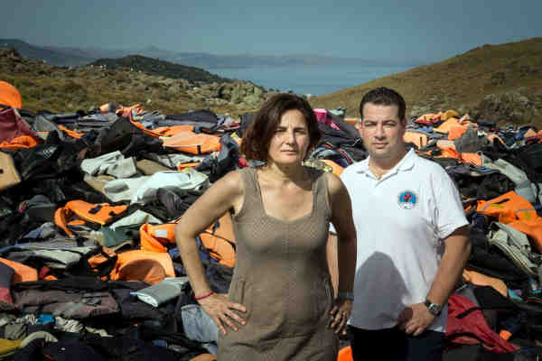 Efi Latsoudi, human rights activist behind PIKPA camp, and Hellenic Rescue Team leader Konstantinos Mitragas, in front of a vast pile of lifejackets in northern Lesvos, a haunting reminder of the dangers faced by refugees who arrived on Greek shores in 2015. Photo: UNHCR/Gordon Welters