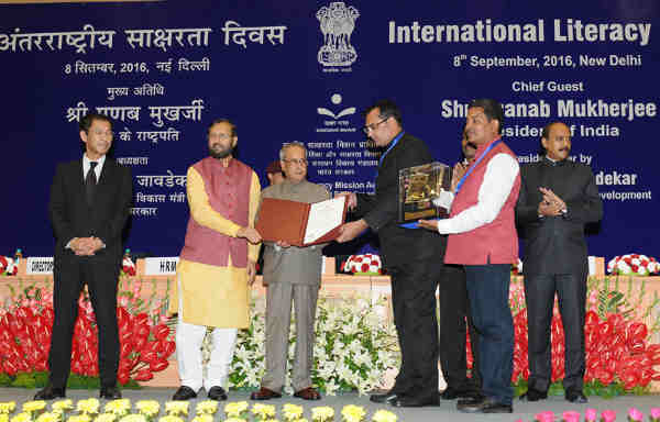 The President Pranab Mukherjee gave away the Saakshar Bharat awards, at the International Literacy Day celebrations, in New Delhi on September 08, 2016. The Union Minister for Human Resource Development Prakash Javadekar is also seen.