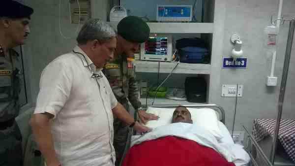 India's Defence Minister Manohar Parrikar visiting a hospital