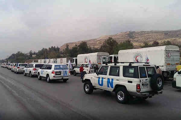 UN aid trucks arrive in the Syrian town of Madaya, which has been slowly starving since October 2015. Photo: OCHA/G. Seifo