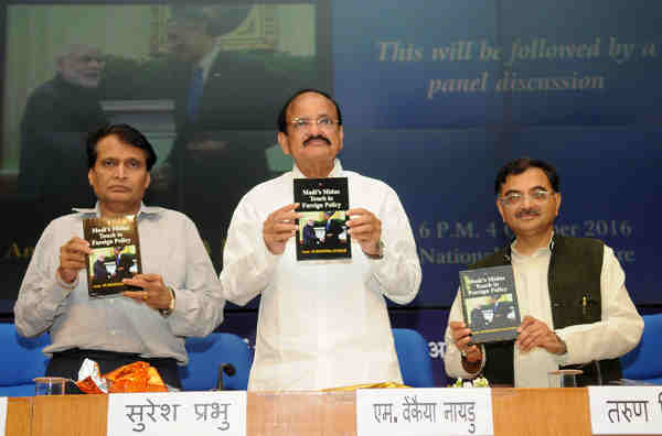 "The Union Minister for Urban Development, Housing & Urban Poverty Alleviation and Information & Broadcasting, Shri M. Venkaiah Naidu along with the Union Minister for Railways, Shri Suresh Prabhakar Prabhu releasing the book ""Modi's Midas touch in Foreign Policy"", written by Ambassador Surendra Kumar, in New Delhi on October 04, 2016"