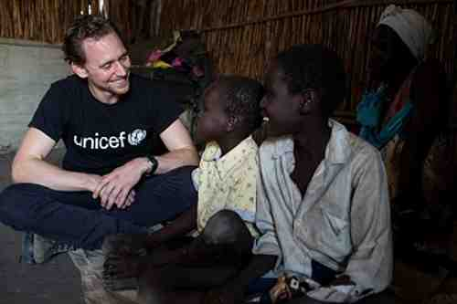 UNICEF Ambassador Tom Hiddleston meets brothers Buom, 12 (right) and Jal, 9, who have been separated from their mother since the conflict began in 2013, at the Protection of Civilians camp in Bentiu, South Sudan, on 25 November 2016.