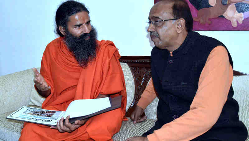 Yoga Guru Baba Ramdev meeting Minister Vijay Goel to promote yoga in sports - in New Delhi on December 06, 2016