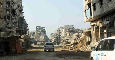 UN vehicles travel along a road lined with remnants of destroyed buildings, Homs, Syria. (file) Photo: UNICEF / UNI178367/ Tiku