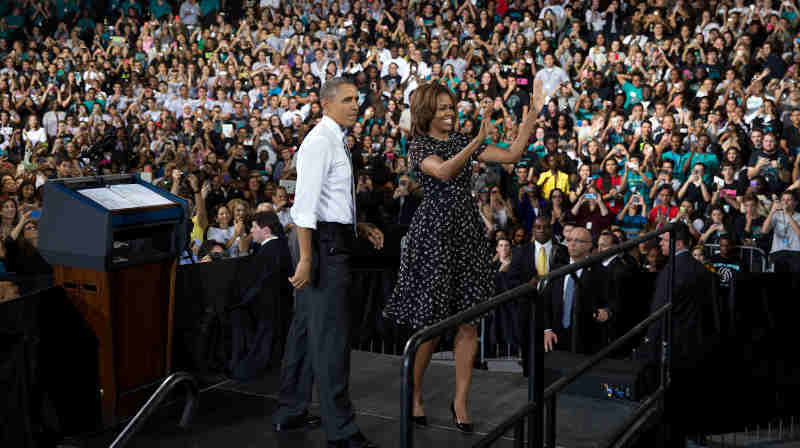 President Barack Obama and First Lady Michelle Obama acknowledge the crowd after the President spoke at Coral Reef Senior High School, Fla., March 7, 2014. (Official White House Photo by Pete Souza)
