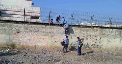 Students of a government school in Delhi cross high walls and barbed wires to abscond from the school. School education is bad and teachers have no control on students. Photo: Rakesh Raman / RMN News Service