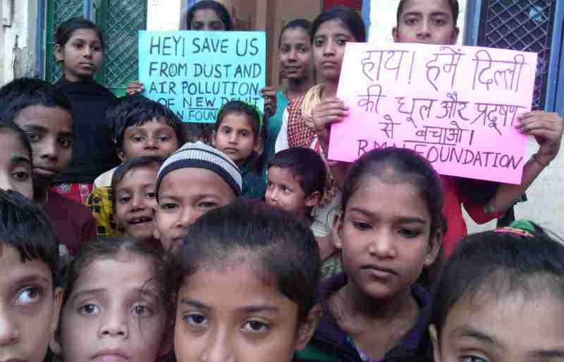 Children affected by dust and air pollution at the RMN Foundation free school for deserving children in Delhi. Photo by Rakesh Raman